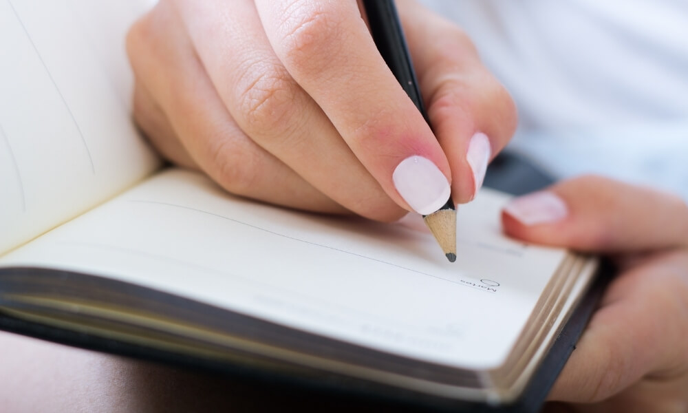 Person writing their business vision