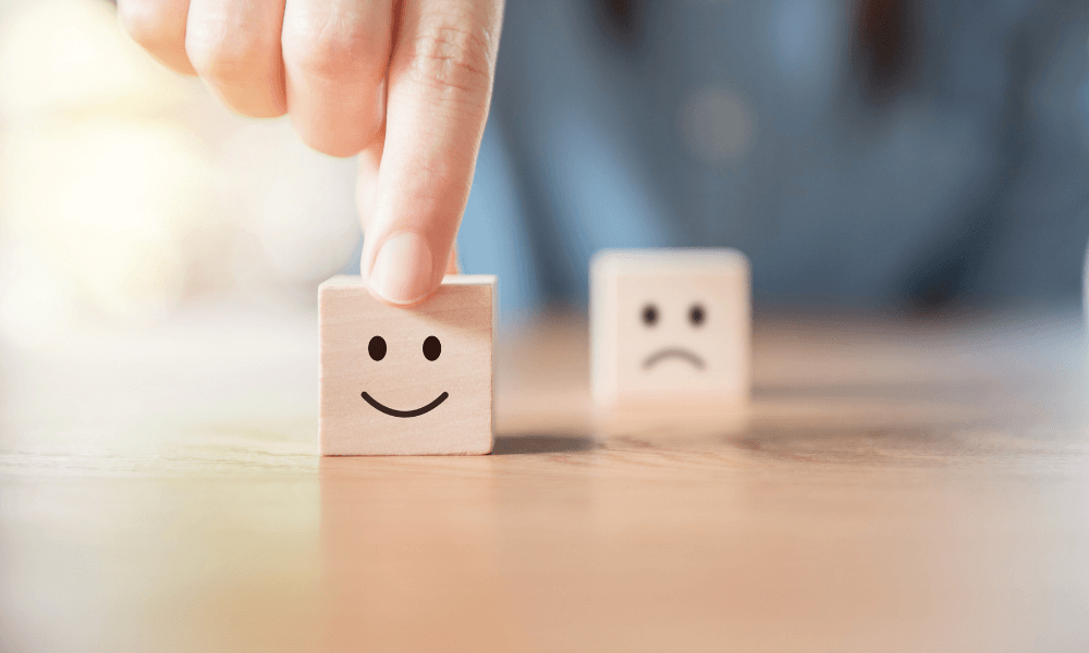 wooden blocks with happy and sad face